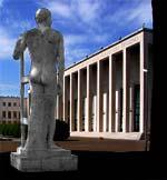 La statua di Fausto Melotti si redimono i campi vista dal retro e sullo sfondo il palazzo uffici